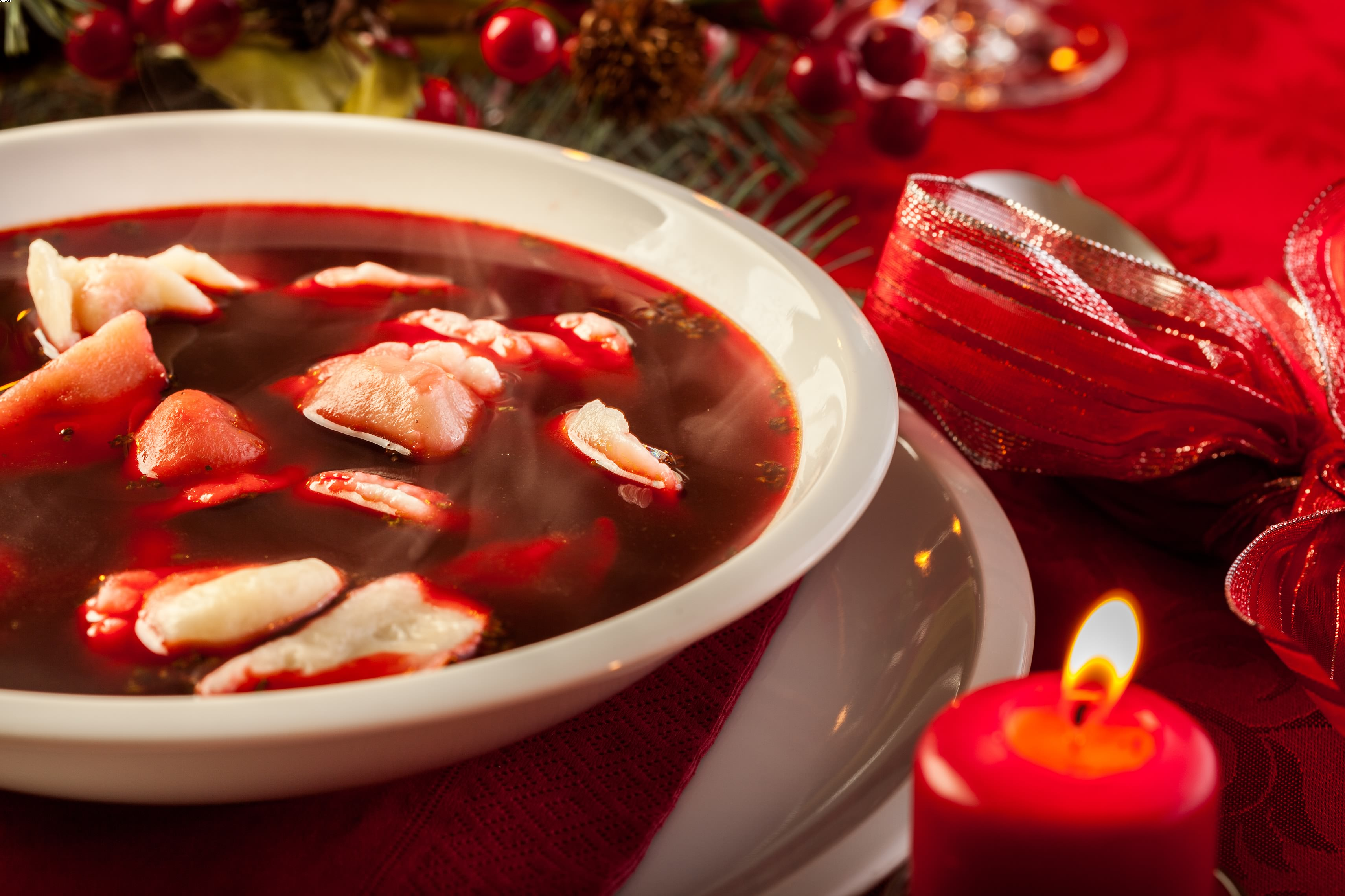 Christmas red borscht with meat filled dumplings